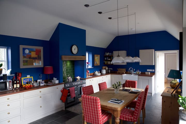 The kitchen, available for use by arrangement. Also where breakfast is served, though guests are welcome to eat upstairs in the sitting area.