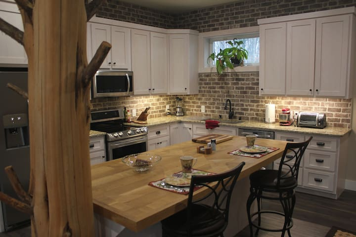Eat in kitchen with handmade oak bar countertop perfect for cooking conversations
