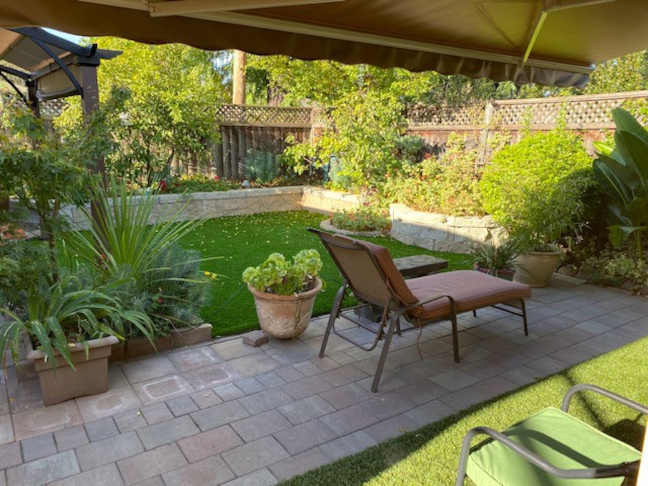 We love the outdoor, and I know our guests love it too, so we made lots of effort to take care of the back yard, you can enjoy it all year long. It's private, as there is no other rooms facing the backyard, except occasional visits from our cats.