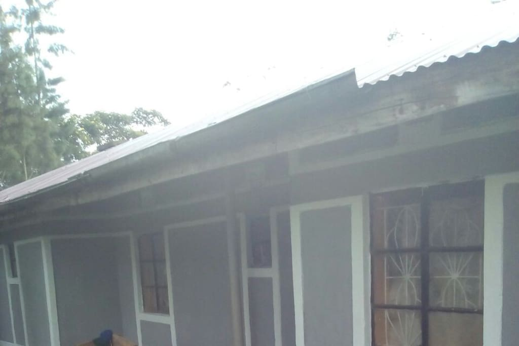 house one  with four bedrooms shower toilet , kitchen dining and large sitting room. sitts twenty five people