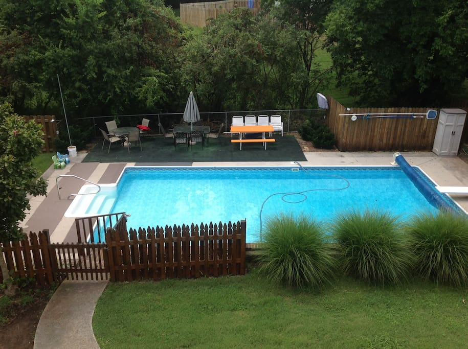 Extremely well kept pool with solar blanket for swimming and relaxation during warm months