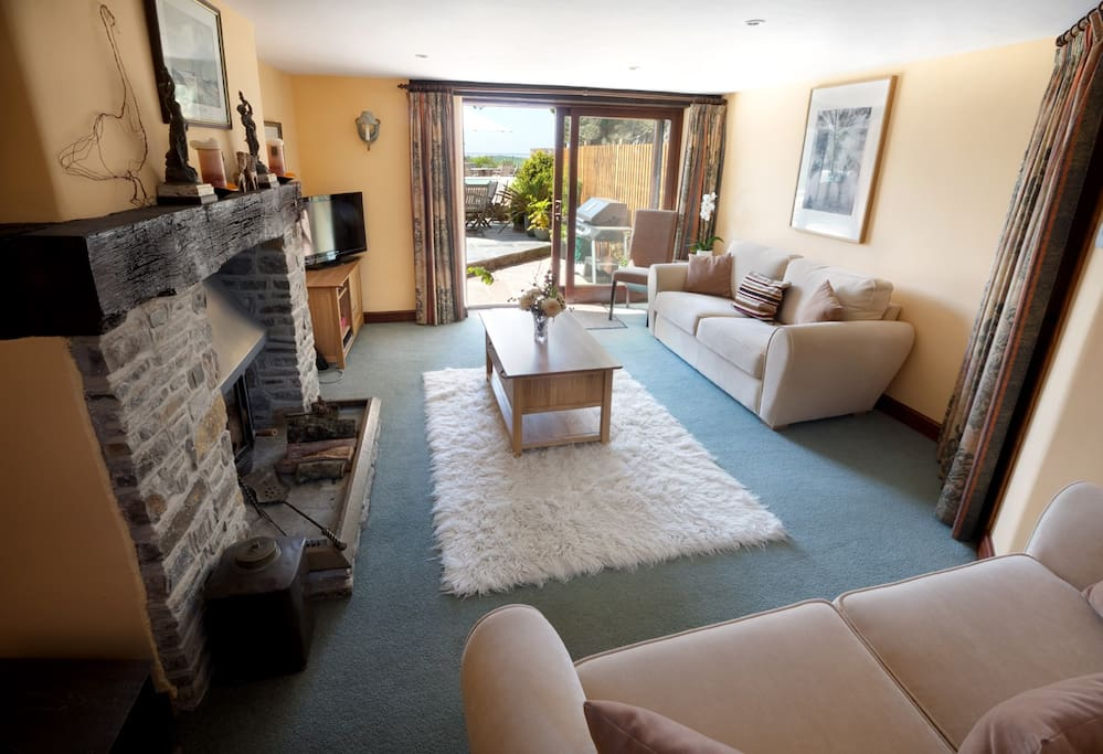Private lounge with cosy wood-burner for any cooler evenings