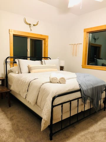 Two of the charming bedrooms feature a queen bed.