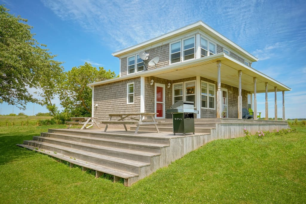 Enjoy our spacious farmhouse and the large deck