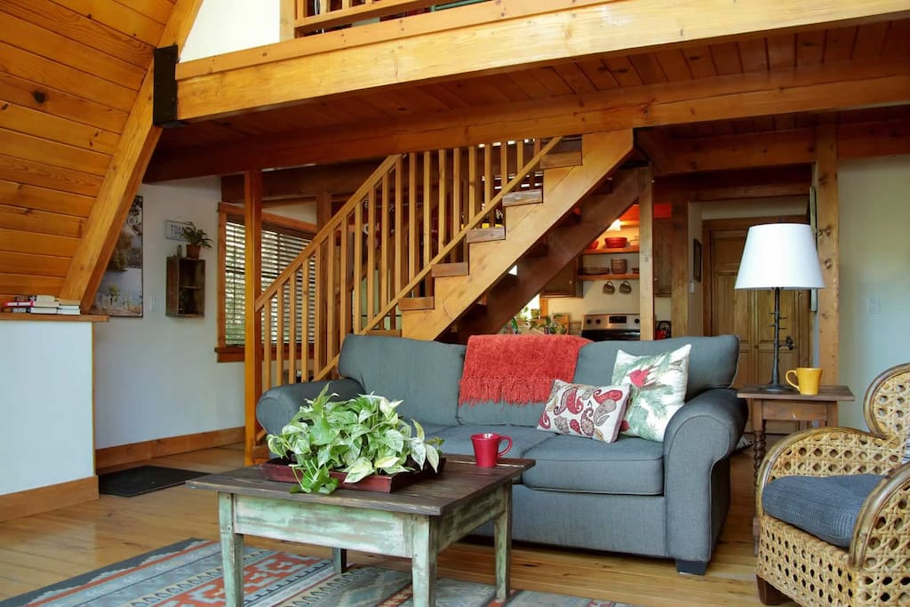 All the creature comforts you'll need, that's the stairway to the loft bedroom.