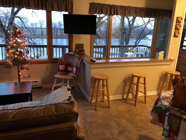Living room area with  river view and small TV
