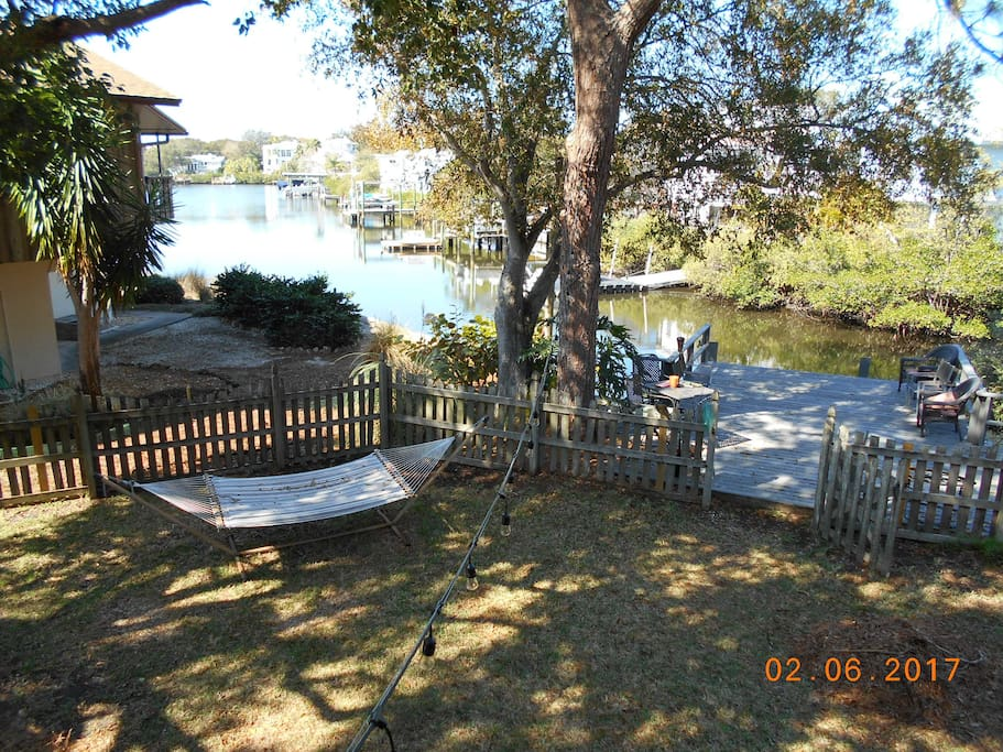 Lay on the hammock or lounge on the dock overlooking Gulf Of Mexico Canal w/ exotic birds, fish and maybe even a dolphin or manatee