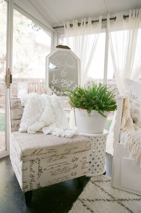 Bright and airy sunroom.  Great area for a quiet time and entertaining.