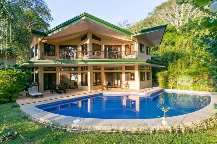 The pool literally wraps around the villa.
