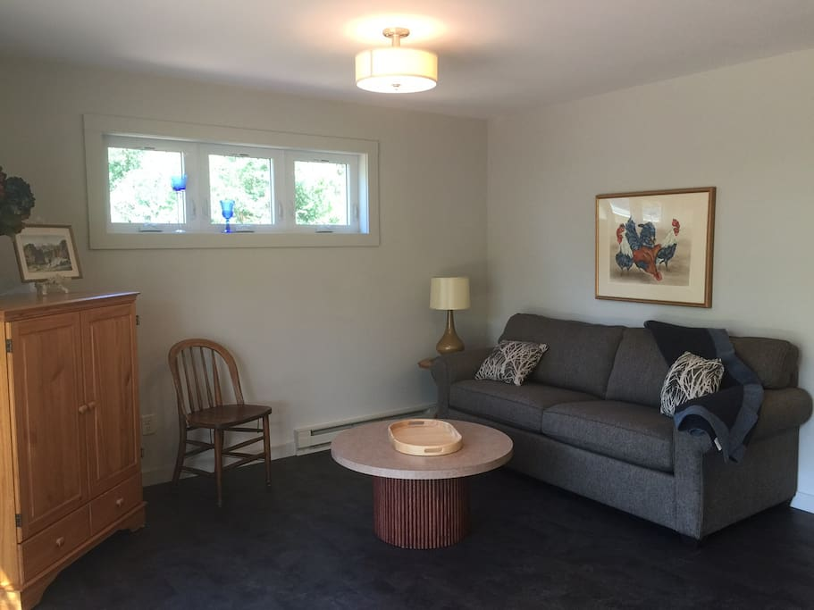 Living room with walk-out patio. (photo is of Unit #2 but Unit #1 is mirror image)
