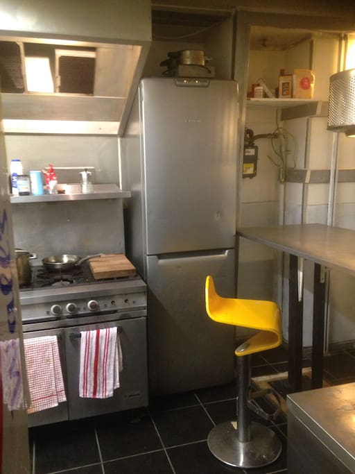 Stainless kitchen with small table.