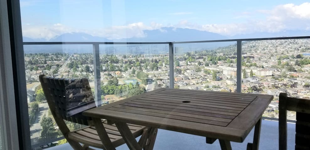 Coffee in the morning from the balcony with a view of North Shore Mountains.