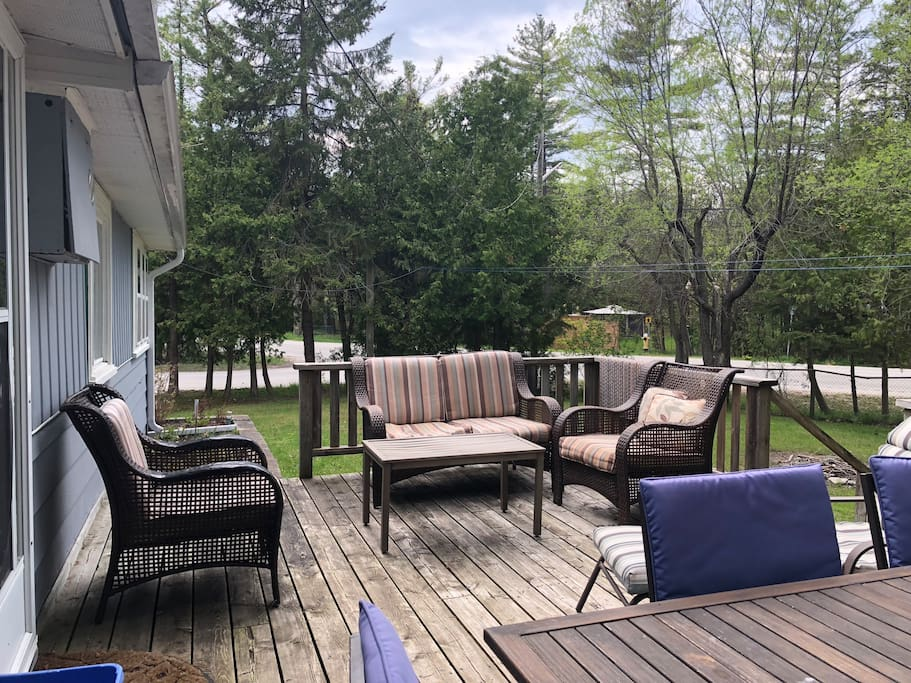 Large deck to relax and enjoy the scenery.  Mature trees surround the property.  Plenty of space for lounging!