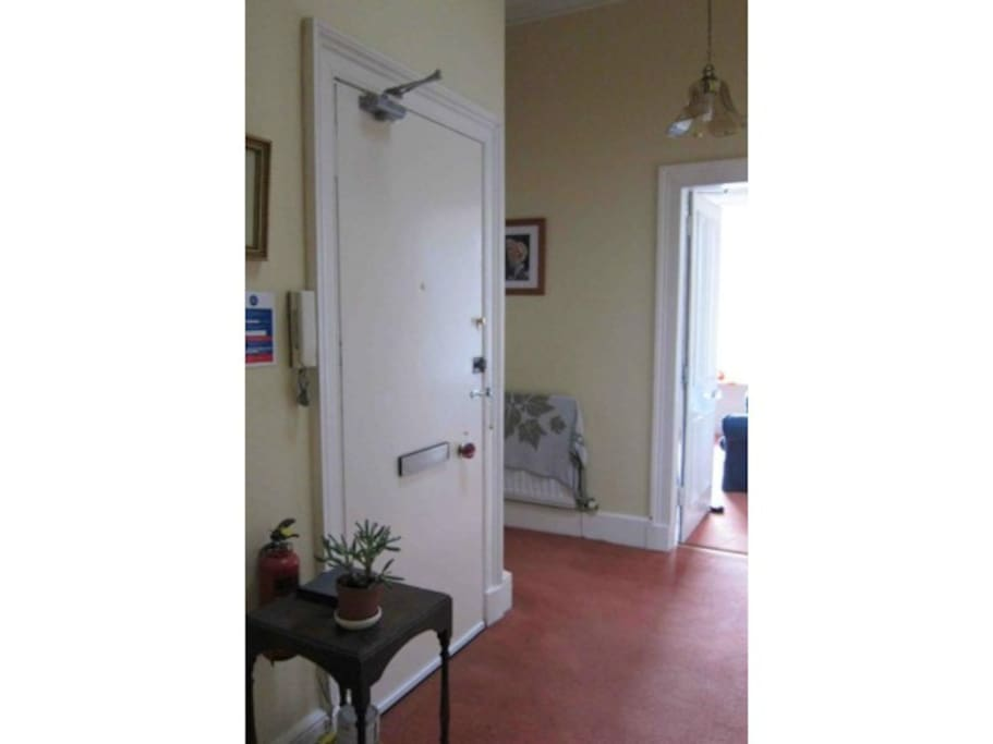The hallway with secure front door / entry phone.