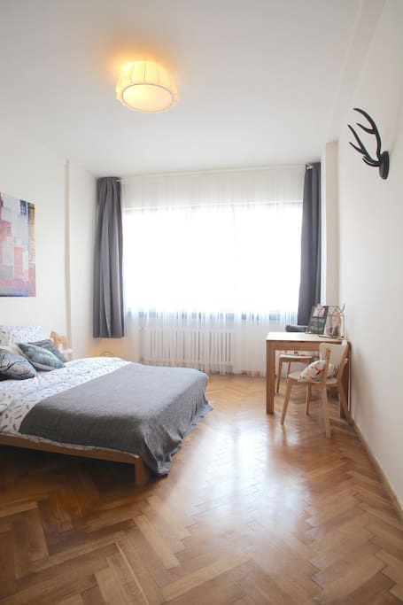 Authentic wooden floors and modern decoration are creating a nice atmosphere in the apartment.