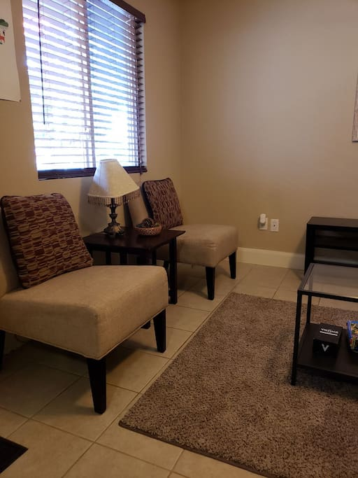 guest chairs with side table and lamp
