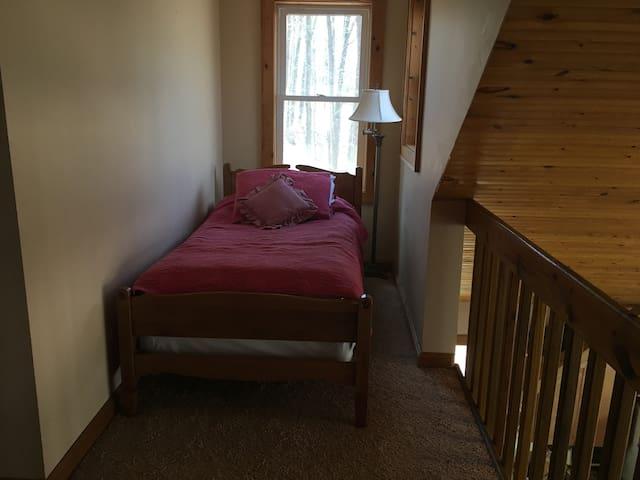 Second floor loft twin bed area
