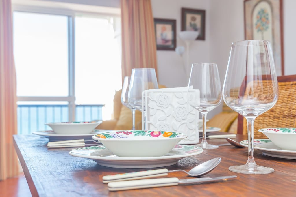 There are all kinds of glasses, dishes and cutlery
