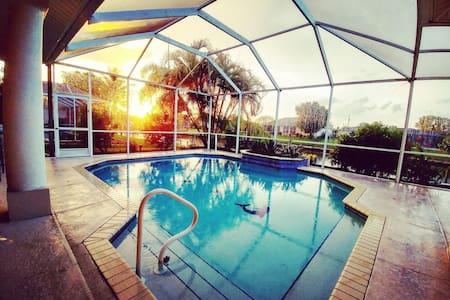 Beautiful Gulf Access Canal Home with Heated Pool