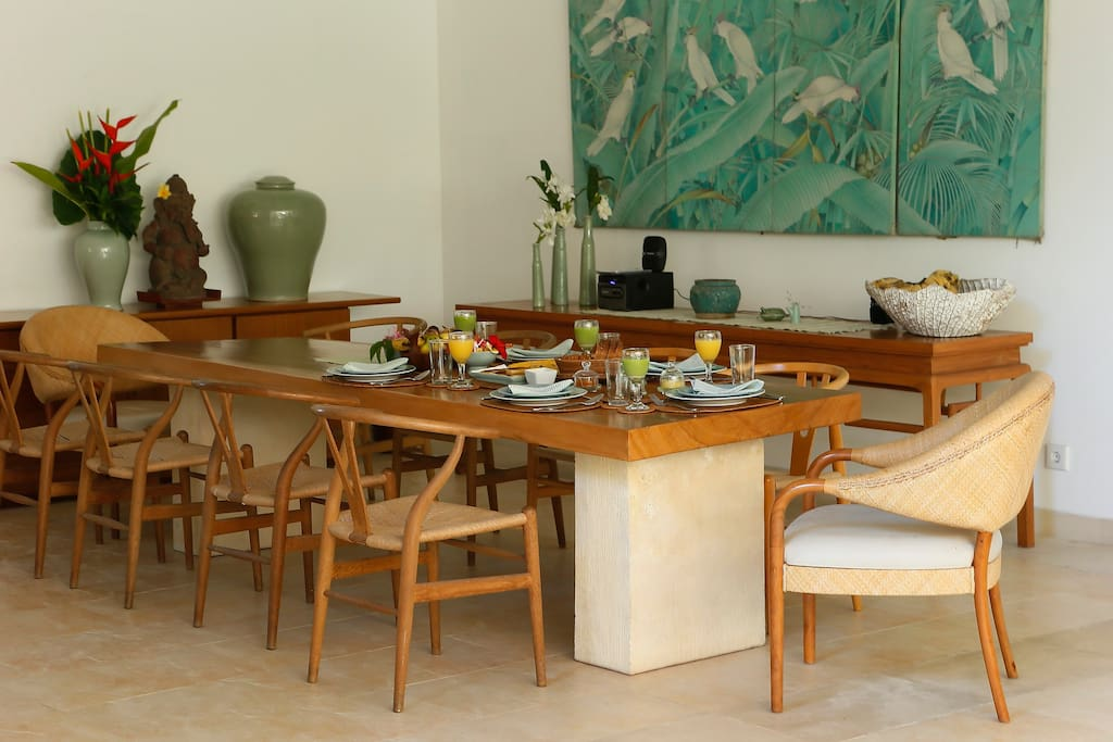 A petrified teak wood that seats 8 and can be used for entertaining