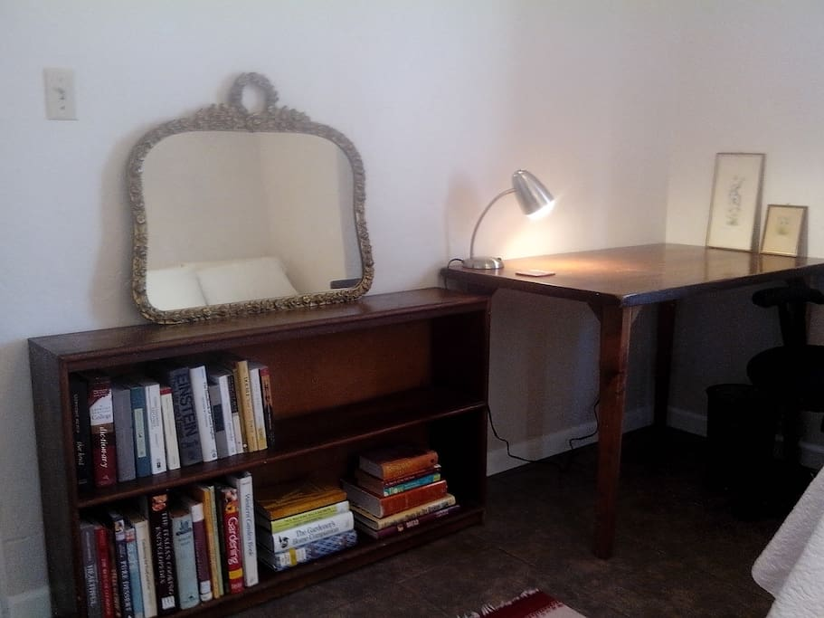 desk and bookshelf on the south wall