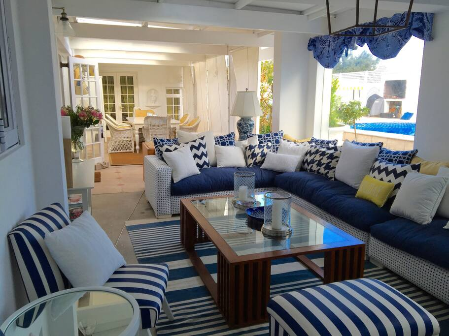 Covered patio with lounge area, TV and breakfast area
