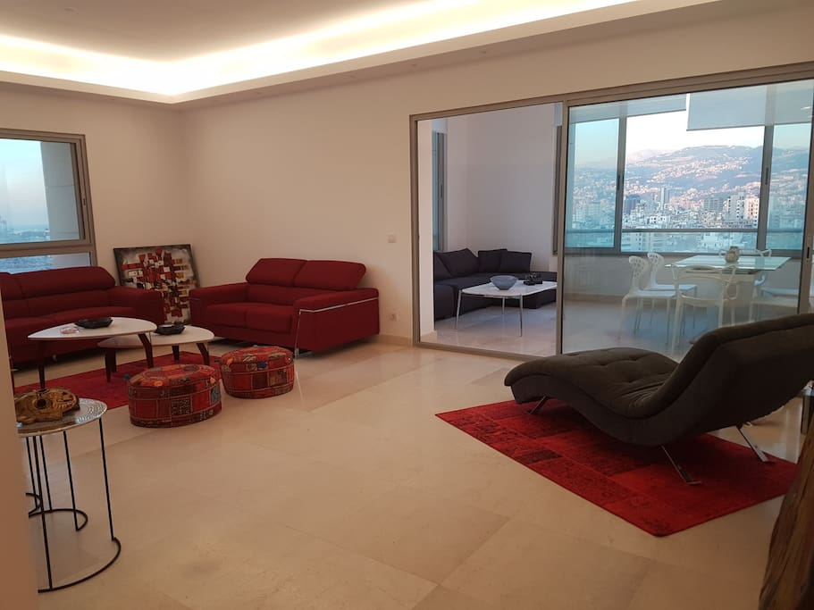 Spacious well-lit living room and dining room