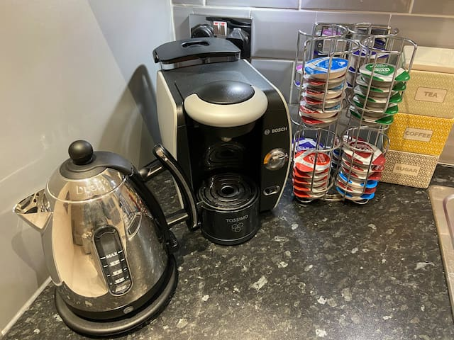 Complementary tea, coffee, sugar and a selection of Tassimo pods.