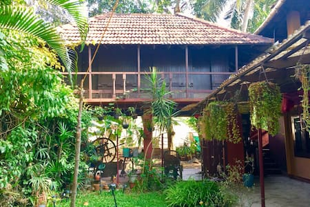 Traditional Keralan wooden cottage in Trivandrum