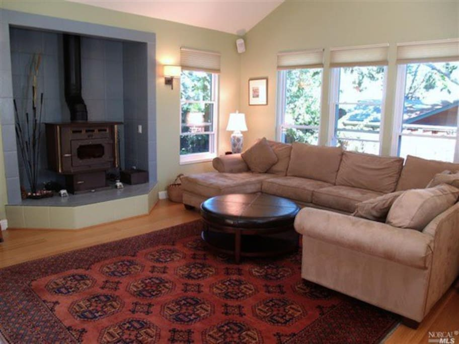 Wood burning fireplace in main room along with big screen tv and comfy couch!