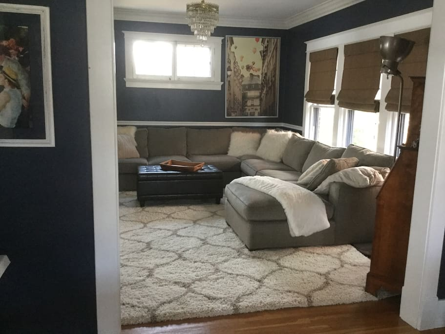 Very cozy family room with large sectional. Great room to listen to music or watch a movie!