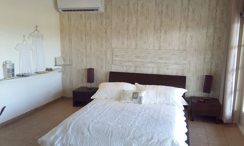 Master Bedroom with Queen size bed and A/C