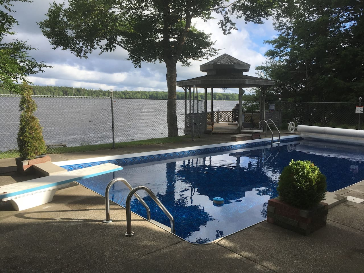 Take a refreshing dip in your private 16 x 36 in ground swimming pool overlooking Victor Lake