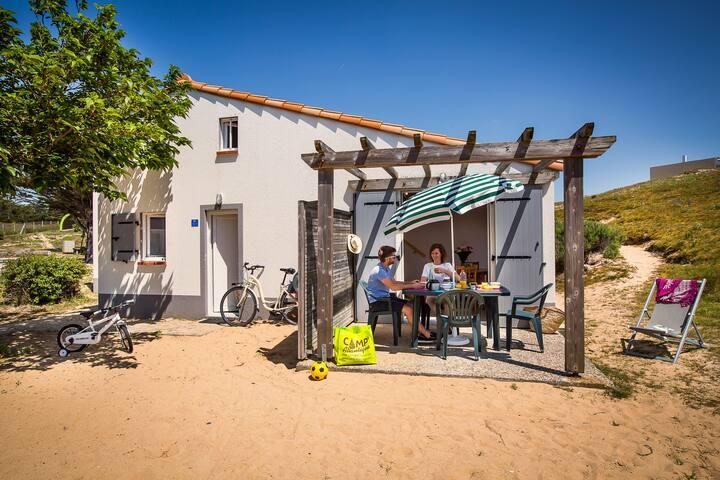 Maisonnette avec accès direct plage