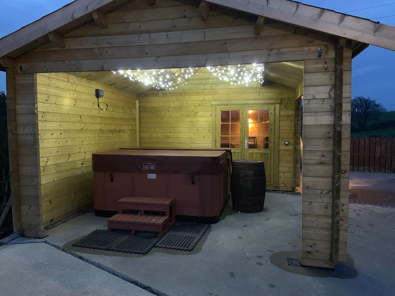Balboa seven seater spa hot tub with 134 jets for massaging and leaving your whole body feeling relaxed. With 26 fibre optic colour changing lights and hydro massage pumps.  Fairy lights are installed above hot tub for ambience sheltered within cabin