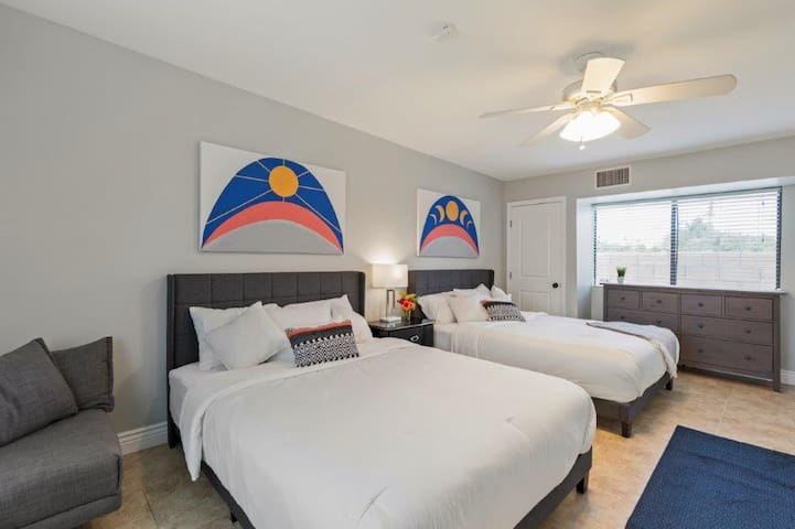 """Back bedroom with 2 queen beds and a 55"""" TV.  Perfect for the kids to have their own hangout space on the other end of the house."""