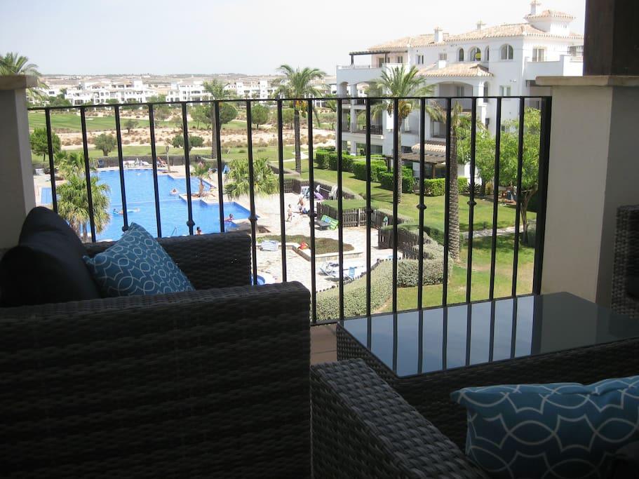 Outdoor furniture overlooking the pool