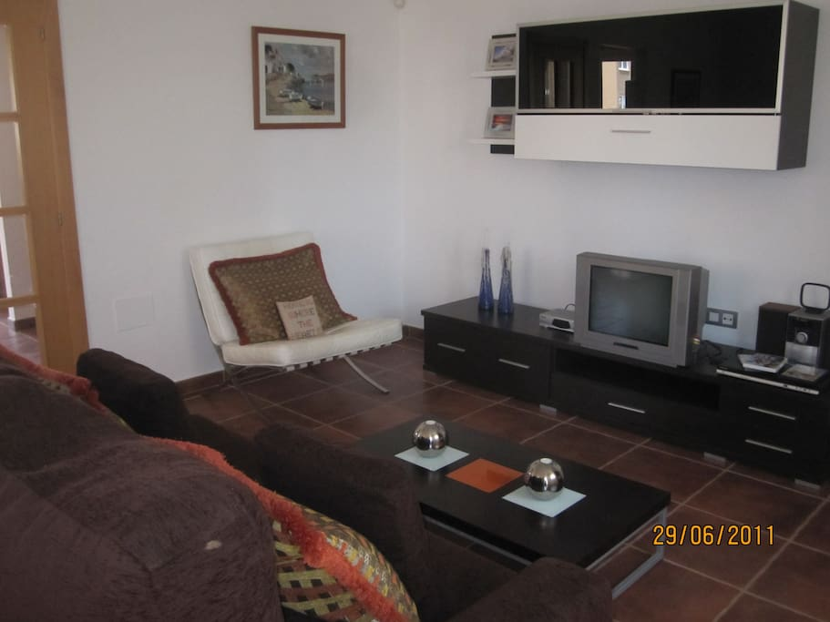 Comfortable light and airy lounge, with all the home comforts, including satellite TV.