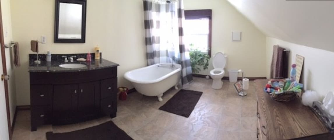 The shared bath is off the kitchen