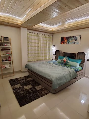 Room Two. Comes with a beautiful teak wood sealing, Oil radiating heater, Smart Tv and a Hot air blowing heater.