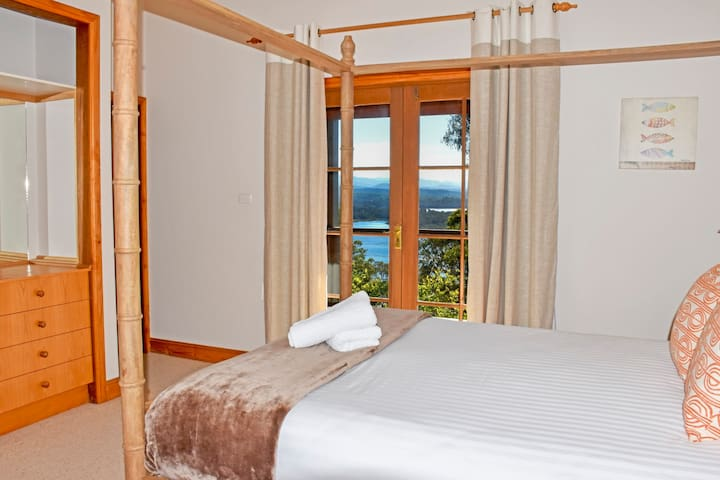 Master suite with queen bed + views & ensuite bathroom. Linen and towels supplied.