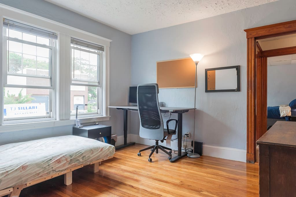 Your large bedroom with Adjustable electric stand/sit large desk+ nice chair (we bought a new queen size bed for our guests)