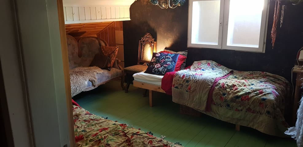 Upstairs bedroom with two single beds