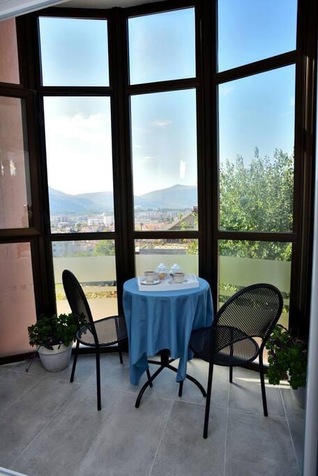 Sunny balcony where you can enjoy morning coffe.