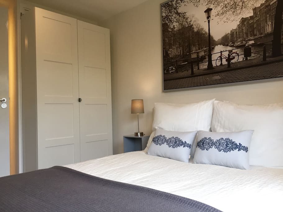 Comfy double bed with wardrobe