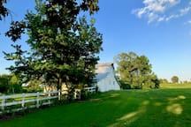 One of the 8 Vintage Barns in view from house