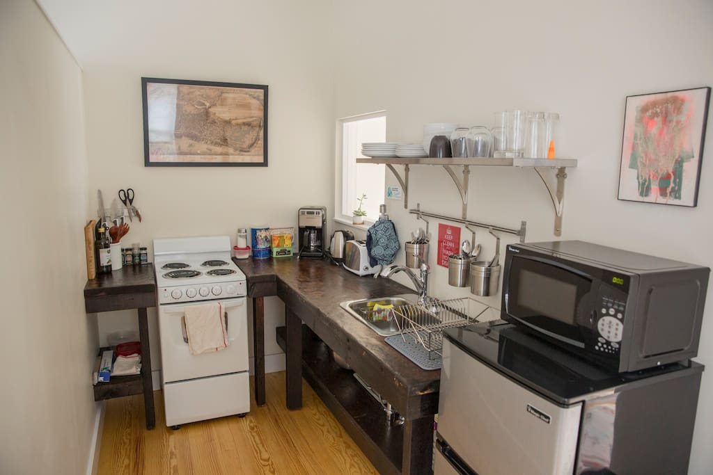Full kitchen w/ Electric Range, Microwave, Coffee Maker, Grinder, pots and pans