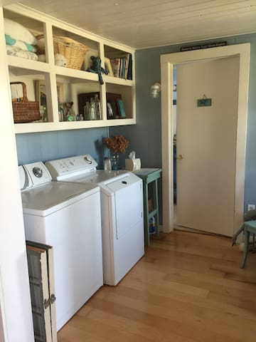 Laundry room and entrance to full bathroom on main level.