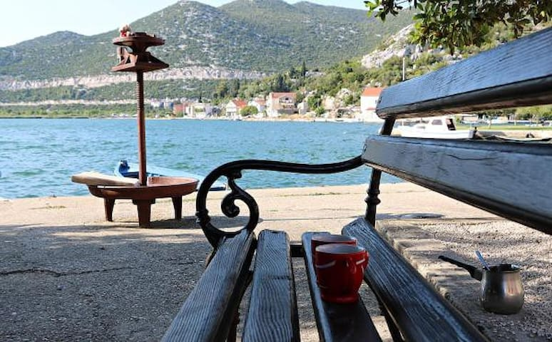 You can also enjoy a cup of coffee or tea in front of the house on a bench near the water.