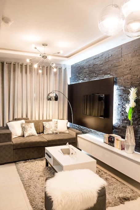 Living room with natural stones wall cladding